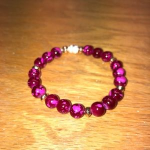 Magenta marble beads with tones of gold